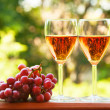 Stock Photo: Glass of pink wine and grape
