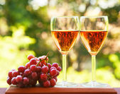 Glass of pink wine and grape — Stock Photo