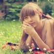 Beautiful Young Girl Lying on Green Grass outdoor. Summer.  — Stockfoto