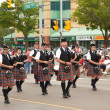 AURORA, ONTARIO, CANADA- JULY 1: Irishmen in their kilt playing their bagpipes during the Canada Day Parade at part of Young Street in Aurora, Canada on July 1, 2013 — Stock Photo