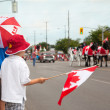 Stock Photo: Boys woching CanadDay parade. Aurora, Ontario, Canada.