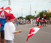 Boys woching a Canada Day parade. Aurora, Ontario, Canada. — Stock Photo