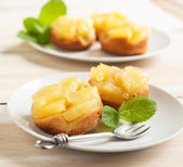 Individual pineapple upside-down cakes — Stock Photo