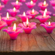 Group of burning candles on wooden background. — Stock Photo