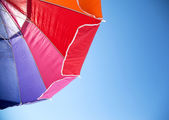 Colorful Beach Umbrella against the Sky — Stock Photo