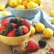 Bowls of berries and fruits — Stock Photo