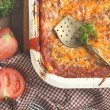 Italian meat lasagna in baking dish — Stockfoto