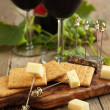 Cheese and crackers with glasses of red wine — Stock Photo