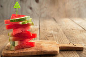 Slices of watermelon on wooden chopping board — Stock Photo