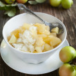 Creamy rice pudding with apple and cinnamon — Stock Photo