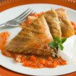 Stuffed cabbage rolls with cream — Stock Photo
