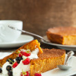 Stock Photo: Slices of carrot cake with whipped cream and berry