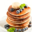 Stack of pancakes with fresh blueberry, maple butter and syrup — Stock Photo #31427705