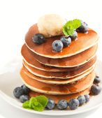 Stack of pancakes with fresh blueberry, maple butter and syrup — Stock Photo