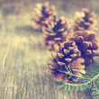 Pine cones on wooden background — Stock Photo