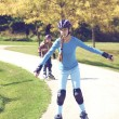 Teenage girl rollerskating in park  — Stock Photo