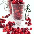 Ripe cranberries in glass cups on white background — Stock Photo #33344535