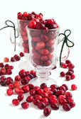 Ripe cranberries in glass cups on white background — ストック写真