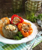 Colorful peppers stuffed with meat, rice and vegetables — Stock Photo