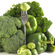Fresh green vegetables on a white background. — Stock Photo