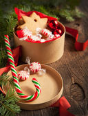 Christmas gift boxes with cookies and candy — Stock Photo