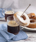 Cup of coffee and donuts — Stock Photo