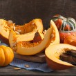 Fresh pumpkins on wooden table — Stock Photo