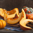 Fresh pumpkins on wooden table — Stock Photo #35970845