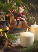 Christmas Decoration with Santa Claus and Candle — Stock Photo