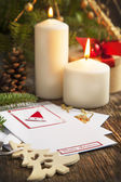 Christmas Decoration with Candles and Greeting card — Stock Photo