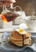 Stack of pancakes with butter and maple syrup — Stock Photo