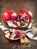Pomegranates over Wooden Background. — Foto de Stock