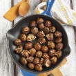 Roasted chestnuts in the pan. — Stock Photo #36431303