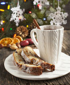 Cup of tea and pieces of Christmas stollen — Stockfoto
