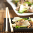 Stir fried bok choy with mushrooms. Small depth of field. — Stock Photo