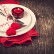 Festive table setting for Valentine's Day with fork, knife and hearts — Stock Photo #37253555