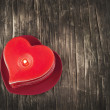 Red burning heart shaped candles on wooden background. — Stock Photo #37557281