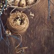 Easter decoration with quail eggs on wooden board. — Stock Photo #38817617