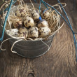 Easter decoration with quail eggs on wooden board. — Stock Photo #38817601