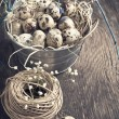 Easter decoration with quail eggs on wooden board. — Stock Photo #38817659