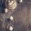 Easter decoration with quail eggs and branches on wooden board — Stock Photo #38817697
