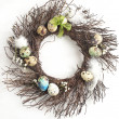 Easter egg wreath on a white wooden background. Selective focus — Stock Photo #39878499