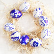 Easter egg wreath on a white wooden background. Selective focus — Stock Photo #39878503
