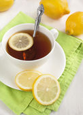 White cup of tea with lemon — Stock Photo