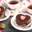 Heart shaped cakes with chocolate and strawberry — Stock Photo