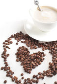 Cup of coffee and coffee beans. — Stock Photo