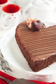 Chocolate cake in the shape of a heart. Selective focus — Foto Stock
