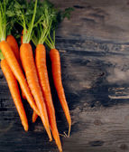 Fresh Organic Carrots on wooden background — Foto Stock