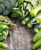 Fresh green vegetables on a wooden background. — Stock Photo