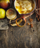 Autumn food background with apples, spices and nuts. — Stock Photo